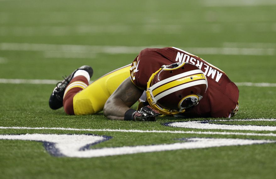 Washington Redskins free safety David Amerson (39) lays on the field after suffering an unknown injury during a punt play to the Dallas Cowboys in the second half of an NFL football game, Sunday, Oct. 13, 2013, in Arlington, Texas. (AP Photo/LM Otero)