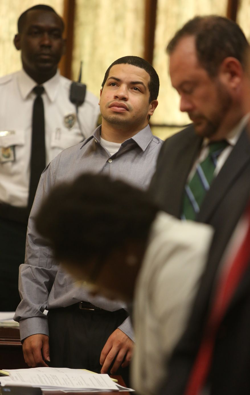 Eric Rivera Jr., center,  stands in court Tuesday, Oct. 15, 2013, in Miami. Rivera is accused  in the 2007 slaying of Washington Redskins star safety Sean Taylor during what police say was a botched burglary attempt. ((AP Photo/The Miami Herald, Walter Michot,pool)
