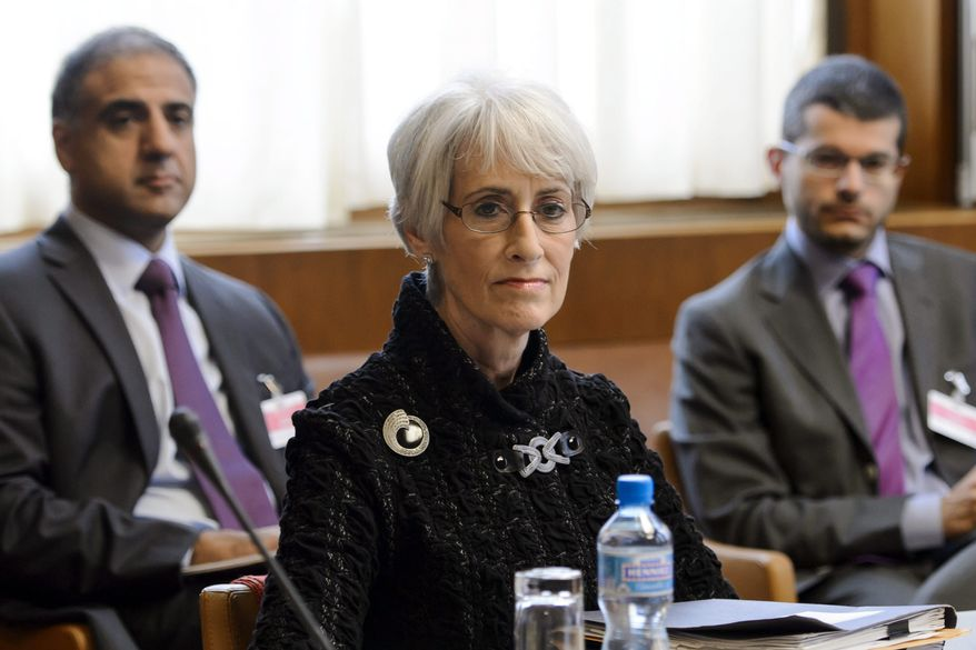 U.S. Under Secretary for Political Affairs Wendy Sherman, center, waits for the start of the two days of closed-door nuclear talks on Tuesday, Oct. 15, 2013, at the United Nations offices in Geneva, Switzerland. Iran's overtures to the West are being tested as the U.S. and its partners sit down for the first talks on Tehran's nuclear program since the election of a reformist Iranian president. Negotiations between Iran and the U.S., Russia, China, Britain, France and Germany began Tuesday morning. (AP Photo/Fabrice Coffrini, pool)