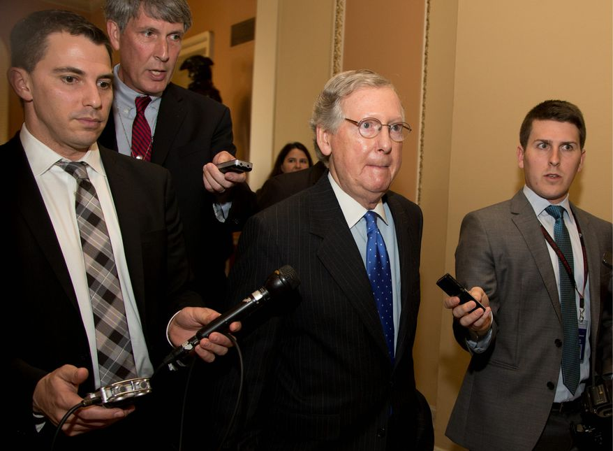shutdown's END: An agreement by Senate Minority Leader Mitch McConnell (left) and Majority Leader Harry Reid reopens the government and averts a debt default. Late Wednesday night, the House approved the Senate bill. (Associated Press photographs)