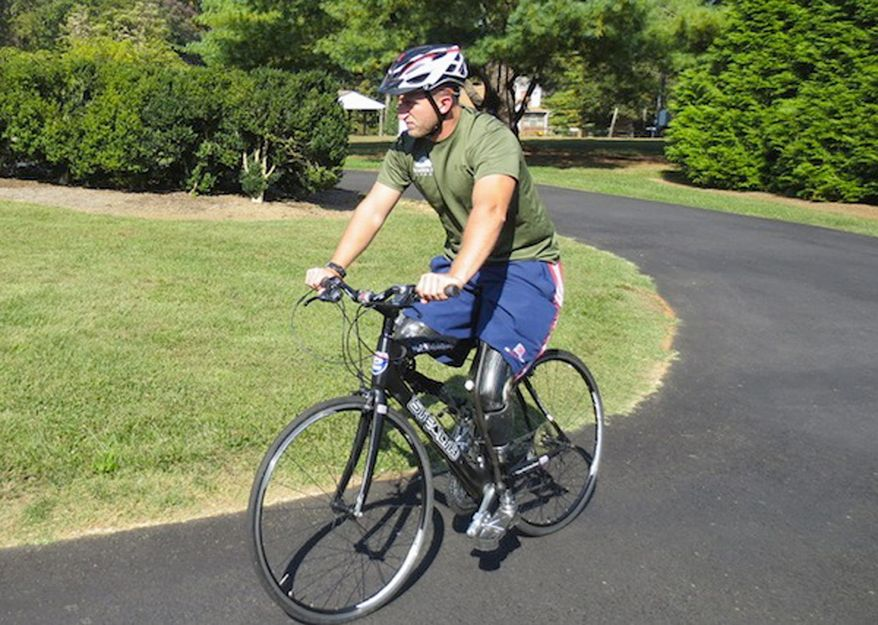 Former Marine Rob Jones, who lost both legs to a roadside explosion in Afghanistan, is pedaling from Maine to far Southern California, hoping to raise $1 million for charity along the way. (Rob Jones)
