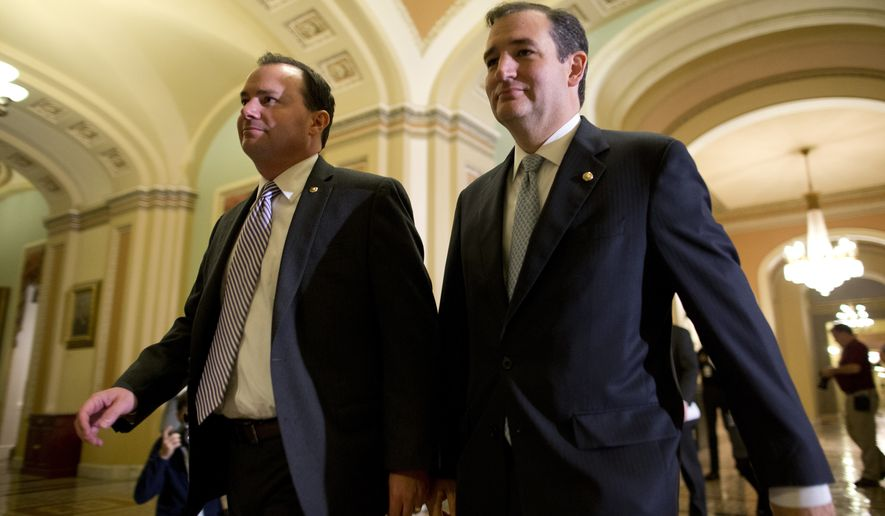 ** FILE ** Sen. Mike Lee, R-Utah, left, and Sen. Ted Cruz, R-Texas, walk to the Senate floor to vote on a bill to raise the debt ceiling and fund the government on Capitol Hill on Wednesday, Oct. 16, 2013 in Washington. (AP Photo/ Evan Vucci)