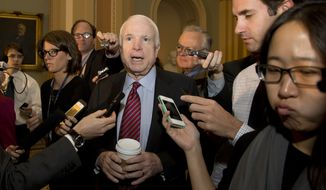 Sen. John McCain, R-Ariz., is followed by reporters on Capitol Hill, Wednesday, Oct. 16, 2013, in Washington. Time is growing short for Congress to prevent a threatened Treasury default and stop a partial government shutdown. (AP Photo/Carolyn Kaster)