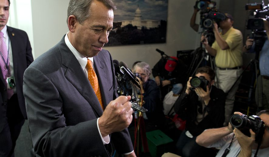 Speaker of the House Rep. John Boehner, R-Ohio, pumps his fist as he walks past reporters after a meeting with House Republicans on Capitol Hill on Wednesday, Oct. 16, 2013 in Washington. The partial government shutdown is in its third week and less than two days before the Treasury Department says it will be unable to borrow and will rely on a cash cushion to pay the country's bills. (AP Photo/ Evan Vucci)