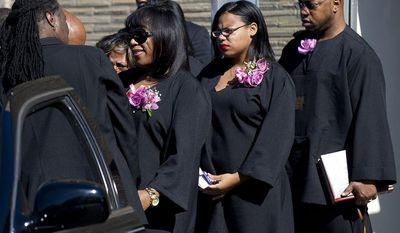 Valarie Carey, sister of Miriam Carey, exits Grace Funeral Chapels after the funeral for Miriam Carey in the Brooklyn borough of New York,  on Tuesday, Oct. 15, 2013.  Carey was shot to death by police after trying to ram her vehicle through a White House barrier.  The dental hygienist from Stamford, Conn., is survived by her 1-year-old daughter, who was in the vehicle during the Oct. 3 car chase through the streets of Washington. Carey had been diagnosed with postpartum depression and psychosis. Authorities say she believed President Barack Obama was monitoring her electronically. (AP Photo/The Stamford Advocate, Lindsay Perry)    MANDATORY CREDIT