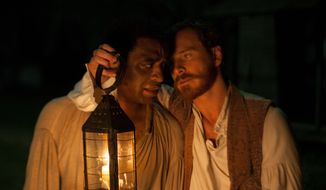 "This image released by Fox Searchlight shows Chiwetel Ejofor, left, and Michael Fassbender in a scene from ""12 Years A Slave."" (AP Photo/Fox Searchlight, Francois Duhamel)"