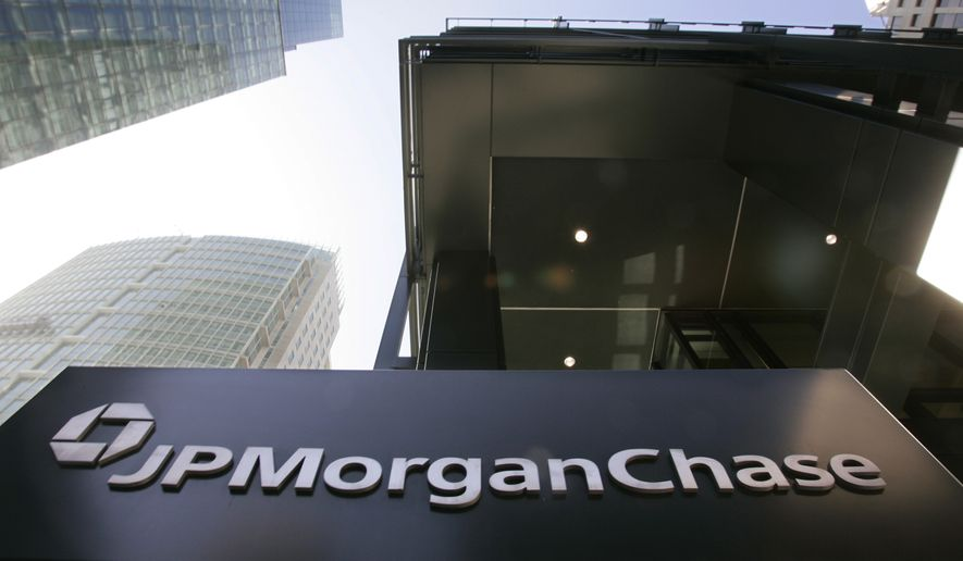 """FILE - This Oct. 15, 2008, file photo, shows the exterior view of JPMorgan Chase offices in San Francisco. In a settlement announced Wednesday, Oct. 16, 2013, JPMorgan Chase & Co., has agreed to pay a $100 million penalty and admitted that it """"recklessly"""" distorted prices during a series of London trades that ultimately cost the bank $6 billion in losses. (AP Photo/Paul Sakuma, File)"""