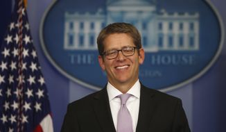 White House Press Secretary Jay Carney smiles as he arrives for the daily press briefing at the White House in Washington, Wednesday, Oct. 16, 2013, after lawmakers reached a bipartisan deal to avoid default and reopen the government. (AP Photo/Charles Dharapak)