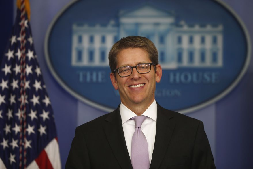 White House press secretary Jay Carney smiles as he arrives for the daily press briefing at the White House in Washington on Wednesday, Oct. 16, 2013, after senators reached a bipartisan deal to avoid default and reopen the government. (AP Photo/Charles Dharapak)