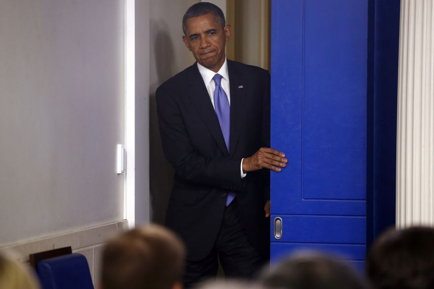 President Barack Obama walks out to make a statement to reporters in the Brady Press Briefing Room at the White House in Washington, Wednesday, Oct. 16, 2013. The Senate voted to avoid a financial default and reopen the government after a 16-day partial shutdown and the measure now heads to the House, which is expected to back the bill before day's end. (AP Photo/Charles Dharapak)