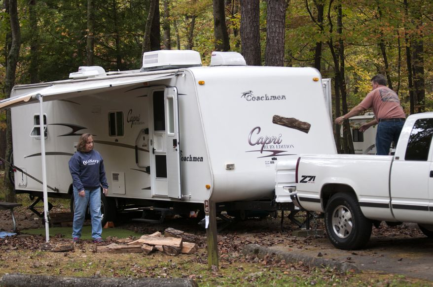 """Earl and Pam Robinson of Chatsworth, Ga., are among the first to get settled into the newly reopened Cades Cove campground in the Great Smoky Mountains National Park near Townsend, Tenn., on Wednesday, Oct. 16, 2013,  The couple have been camping in the Smokies for 23 years and had made reservations six months ago for this trip. """"I could hug the governor's neck, """" said Earl about the reopening of the park. The Tennessee state government and Sevier and Blount counties are paying over $300,000 for five days of operation costs for the park which has been closed due to the partial federal government shutdown. North Carolina is adding $75,000. (AP Photo/Knoxville News Sentinel, Paul Efird)"""
