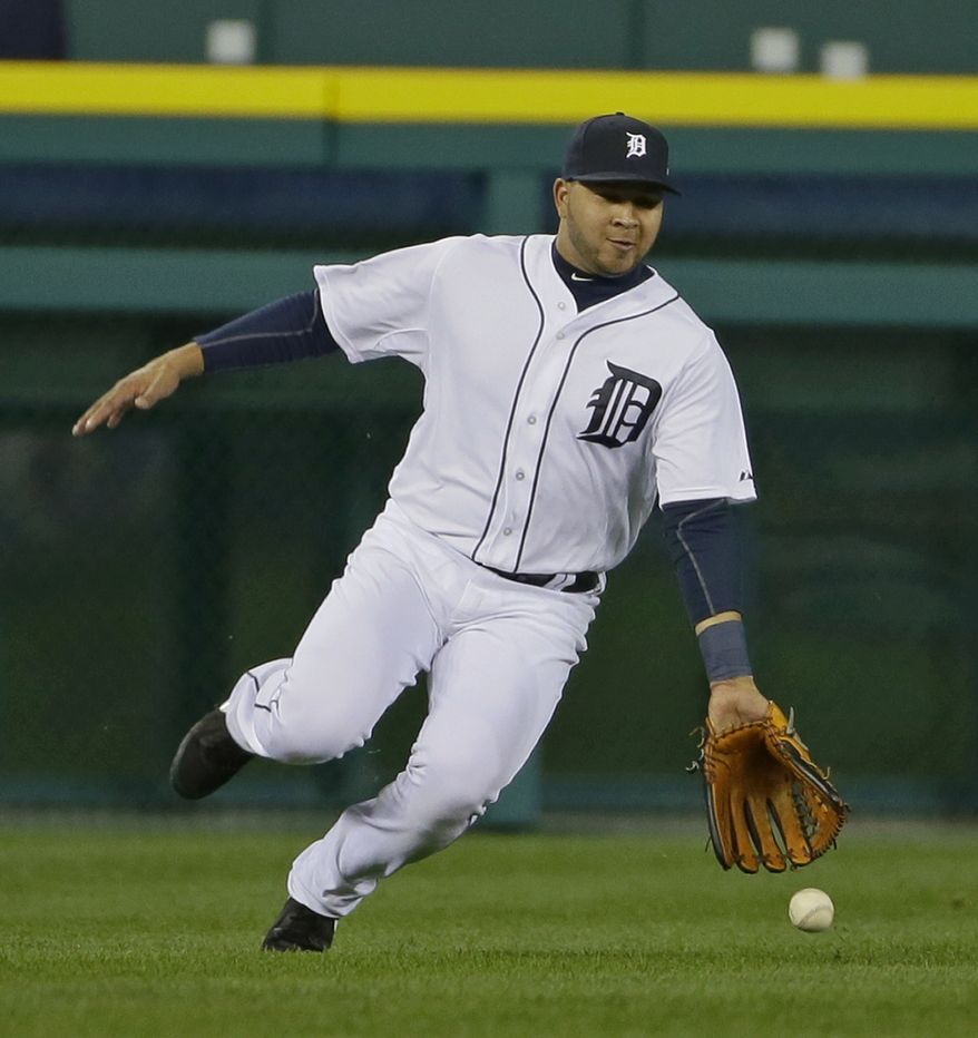 Detroit Tigers' Jhonny Peralta goes for a ball hit by Boston Red Sox's David Ortiz in the fourth inning during Game 5 of the American League baseball championship series Thursday, Oct. 17, 2013, in Detroit. (AP Photo/Matt Slocum)