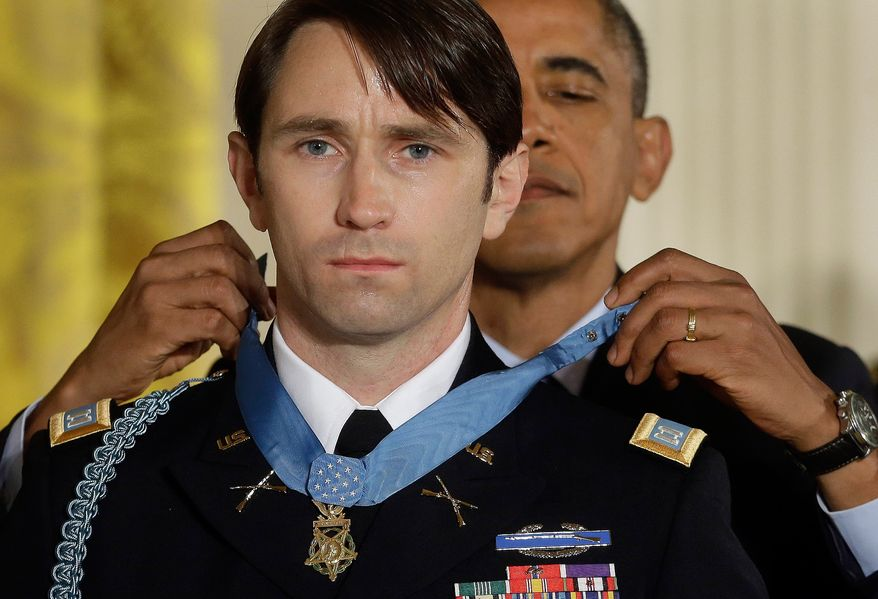 AP10ThingsToSee - President Barack Obama awards the Medal of Honor to former Army Capt. William D. Swenson of Seattle, Wash., during a ceremony in the East Room at the White House in Washington, Tuesday, Oct. 15, 2013. Swenson was being awarded the Medal of Honor for his actions in a lengthy battle against Taliban insurgents in the Ganjgal valley near the Pakistan border on Sept. 8, 2009, which claimed the lives of five Americans, 10 Afghan army troops and an interpreter. (AP Photo/Pablo Martinez Monsivais, File)