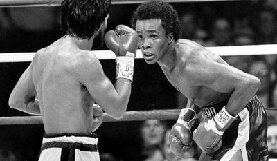 FILE - In this Nov. 25, 1980 file photo, Sugar Ray Leonard, right, taunts at Roberto Duran in the ring during a WBC Welterweight Championship fight refereed by Octavio Meyran in New Orleans, La. Leonard won the rematch fight and the title in the eighth round.  (AP Photo, File)
