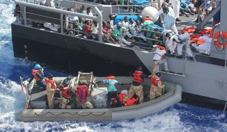 In a photo provided by the U.S. Navy, distressed persons are transferred Thursday, Oct. 17, 2013 from the USS San Antonio to Armed Forces of Malta offshore patrol vessel P52 after the American vessel came to the rescue of 128 men men adrift in an inflatable raft  in the Mediterranean Sea, Wednesday, Oct. 16, 2013. They were responding to a call by the Maltese Government. The USS San Antonio provided food, water, medical attention, and temporary shelter to the rescued. (AP Photo/U.S. Navy)