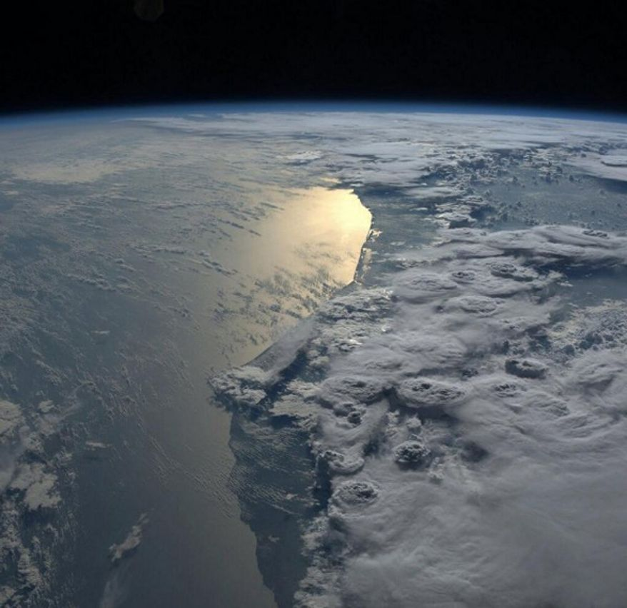 US astronaut Karen Nyberg tweeted this striking photo of storm clouds above Ghana  as seen from the International Space Station.on October 8, 2013. Credit Karen Nyberg NASA
