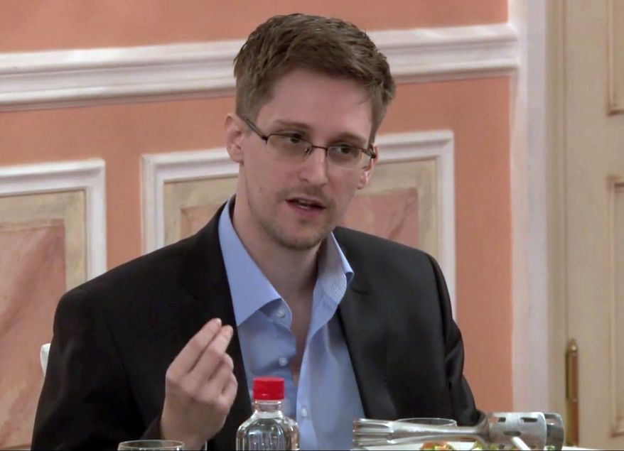 ** FILE ** Former National Security Agency contractor Edward Snowden speaks during a presentation ceremony for the Sam Adams Award in Moscow in this image made from video and released by WikiLeaks on Friday, Oct. 11, 2013. (AP Photo)
