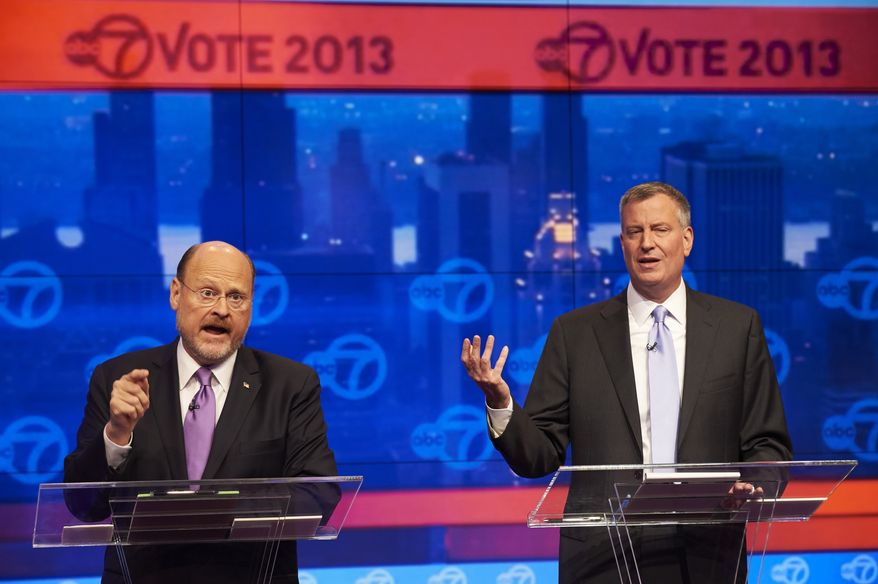 Joe Lhota (left) and Bill de Blasio, the Republican and Democratic candidates, respectively, for New York City mayor, participate in their first televised debate at the WABC-TV (Channel 7) studios on Tuesday, Oct. 15, 2013, in New York. The debate, the first of three before the Nov. 5 general election, was hosted by the New York Daily News, WABC-TV, Noticias 41 Univision and the League of Women Voters. (AP Photo/The Daily News, James Keivom, Pool)