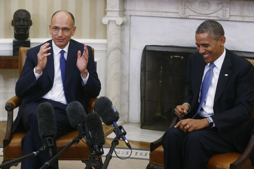 President Barack Obama smiles as Italy's Prime Minister Enrico Letta makes a statement to reporters in the Oval Office at the White House in Washington, Thursday, Oct. 17, 2013. The leaders discussed trade and investment, NATO, North Africa, and the Middle East during their bilateral meeting. (AP Photo/Charles Dharapak)