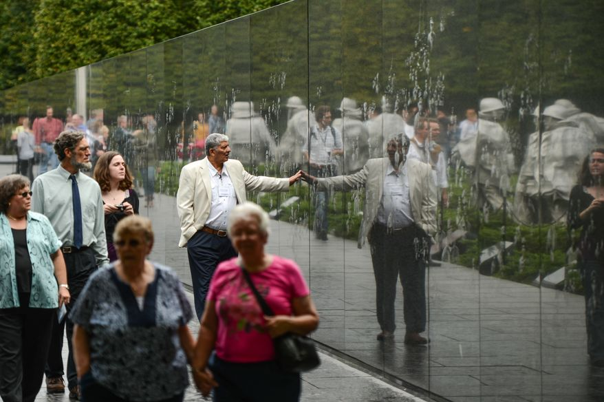 Tourists make their way through the Korean War Veterans Memorial on the first day monuments reopen on the National Mall after the government shutdown, Washington, D.C., Thursday, Oct. 17, 2013. (Andrew Harnik/The Washington Times)