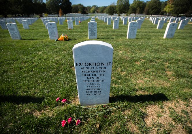 Tombstone 9938, of section 60, in the Arlington National Cemetery,  marks the final resting place for Extortion 17, a group of service members who were killed in action in Afghanistan in 2011,  in Arlington, VA., Friday, October 18, 2013.  (Andrew S Geraci/The Washington Times)
