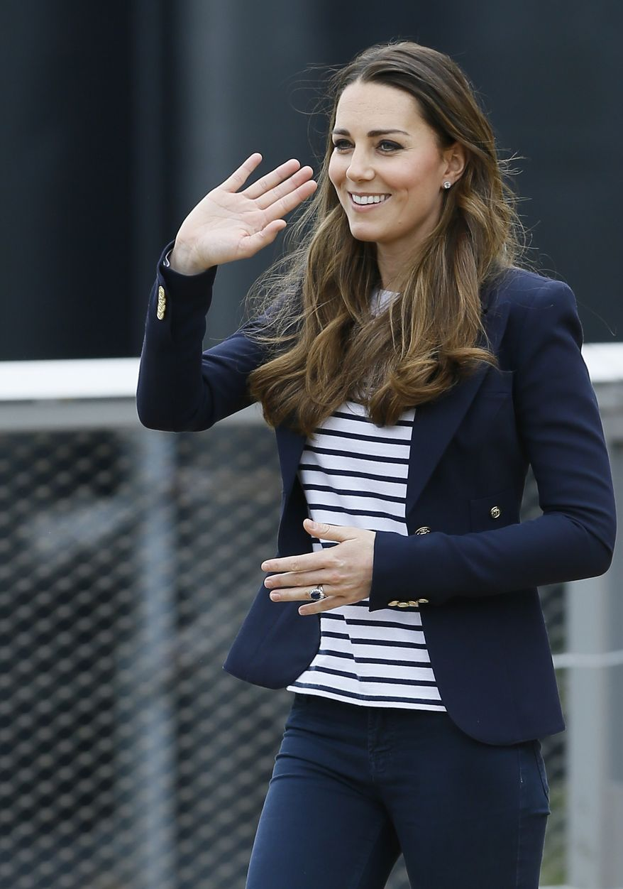 Britain's Kate, The Duchess of Cambridge waves as she leaves after a visit to a SportsAid Athlete Workshop, at the Queen Elizabeth Olympic Park in London, Friday, Oct. 18, 2013. The Duchess of Cambridge as Patron of SportsAid attended a SportsAid Athlete Workshop at the Copper Box where she viewed young athletes taking part in a number of sports activities. (AP Photo/Kirsty Wigglesworth)