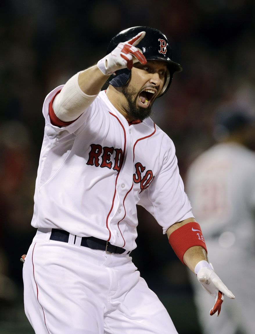 Boston Red Sox's Shane Victorino celebrates his grand slam against the Detroit Tigers as he rounds first base in the seventh inning during Game 6 of the American League baseball championship series on Saturday, Oct. 19, 2013, in Boston. (AP Photo/Charles Krupa