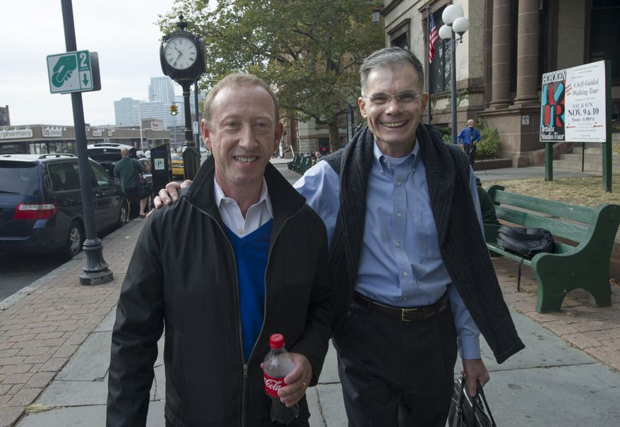 Paul Somerville (left) and Allen Kratz of Hoboken, N.J., leave Hoboken City Hall after applying for a marriage license on Saturday, Oct. 19, 2013. (AP Photo/Joe Epstein)
