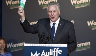 Virginia gubernatorial candidate, DemocratTerry McAuliffe, campaigns at a rally, Women for Terry, at the State Theater in Falls Church, Va. on Saturday, Oct. 19, 2013. During the event former Secretary of State Hillary Clinton formally endorsed her family friend's bid for Virginia governor, marking her first public campaign event since departing the State Department in February. (AP Photo/Jose Luis Magana)