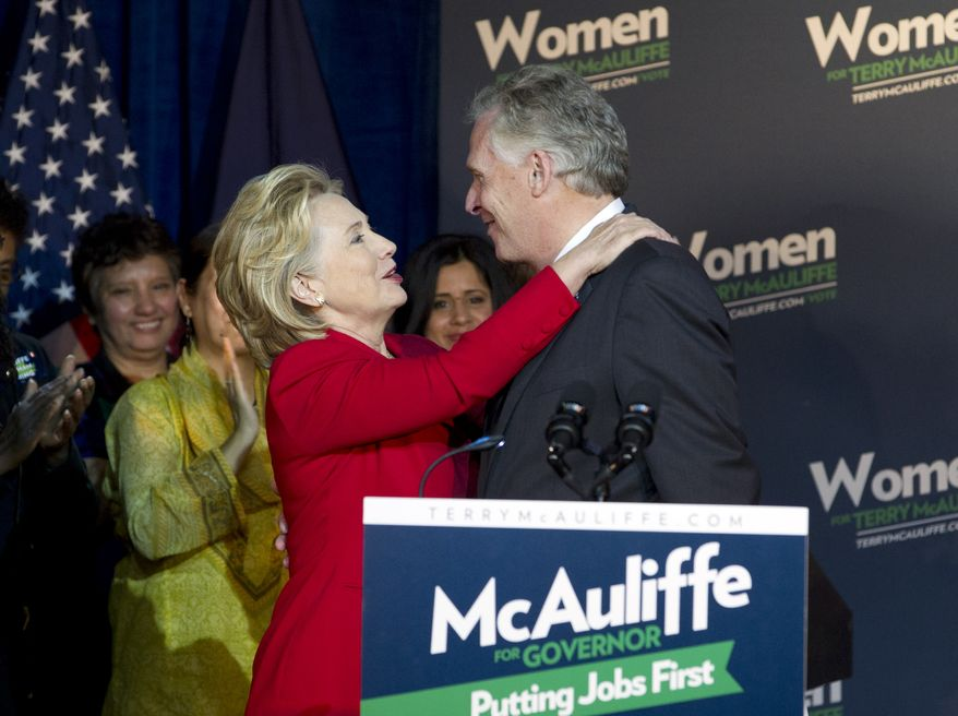 Virginia gubernatorial candidate, Democrat Terry McAuliffe, gets a hug by former Secretary of State Hillary Rodham Clinton during a campaign rally, Women for Terry, at the State Theater in Falls Church, Va. on Saturday, Oct. 19, 2013. Clinton formally endorsed her family friend's bid for Virginia governor, marking her first public campaign event since departing the State Department in February. ( AP Photo/Jose Luis Magana)
