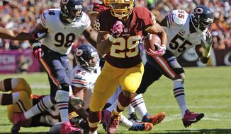 Washington Redskins running back Roy Helu breaks free and heads toward the end zone for a touchdown during the first half of a NFL football game against the Chicago Bears in Landover, Md., Sunday, Oct. 20, 2013. (AP Photo/Nick Wass)