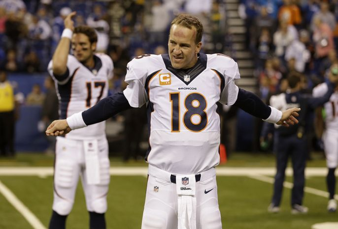 Denver Broncos quarterback Peyton Manning (18) stretches before an NFL football game against the Indianapolis Colts, Sunday, Oct. 20, 2013, in Indianapolis. (AP Photo/Michael Conroy)