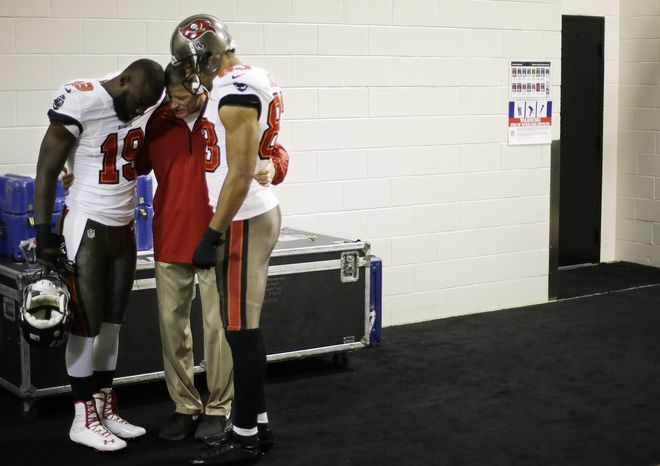 Tampa Bay Buccaneers wide receiver Mike Williams (19) and Tampa Bay Buccaneers wide receiver Vincent Jackson (83) pray with coach John Garrett before the first half of an NFL football game against the Atlanta Falcons, Sunday, Oct. 20, 2013, in Atlanta. (AP Photo/David Goldman)