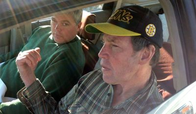 Fred Schaeffer (left) of Raymond, N.H., and George Reynolds (right) of Derry, N.H., sit in a car after being rescued in waters off Salem, Mass., on Saturday, Oct. 19, 2013, after their boat capsized. (AP Photo/WCVB.com, Stanley Foreman)