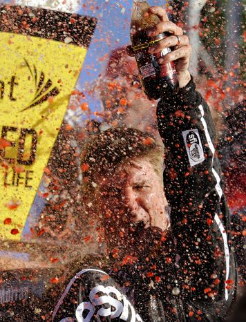 Sprint Cup Series driver Jamie McMurray (1) celebrates after winning the NASCAR Sprint Cup Series auto race at the Talladega Superspeedway in Talladega, Ala., Sunday, Oct. 20, 2013. (AP Photo/Dan Lighton)