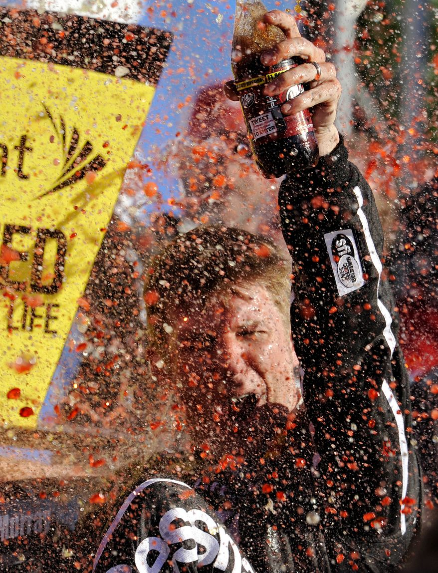 Sprint Cup Series driver Jamie McMurray (1) celebrates after winning the NASCAR Sprint Cup Series auto race at the Talladega Superspeedway in Talladega, Ala., Sunday, Oct. 20, 2013. (AP Photo/Dan Lighton)