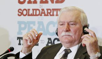 Former Polish President Lech Walesa attends a news conference in Warsaw, Poland, Sunday, Oct. 20, 2013, on the eve of a three-day meeting of Nobel Peace Prize laureates. (AP Photo/Czarek Sokolowski)