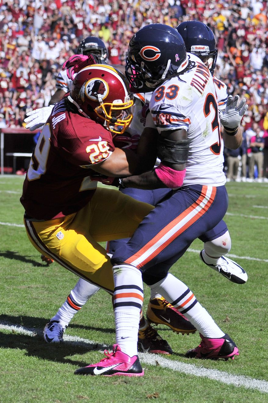 Washington Redskins running back Roy Helu (29) fights off Chicago Bears cornerback Charles Tillman (33) for a 14-yard run in the second quarter at FedExField, Landover, Md., October 20, 2013. (Preston Keres/Special for The Washington Times)