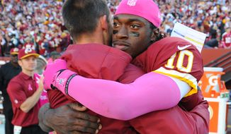 Washington Redskins quarterback Robert Griffin III (10) hugs Offensive Coordinator Kyle Shanhan after defeating the Chicago Bears at FedExField, Landover, Md., October 20, 2013. (Preston Keres/Special for The Washington Times)