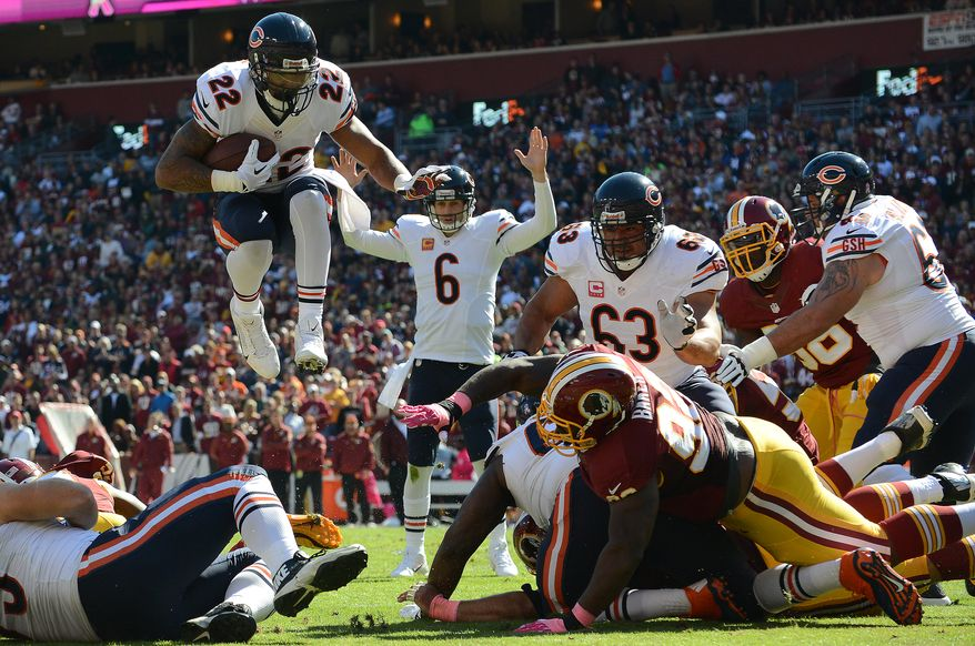Chicago Bears running back Matt Forte (22) leaps into the end zone for a touchdown as the Washington Redskins play the Chicago Bears at FedExField, Landover, Md., October 20, 2013. (Dan DeCook/Special to The Washington Times)