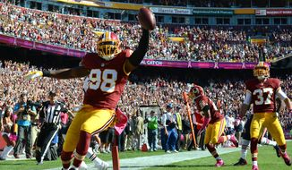 Washington Redskins outside linebacker Brian Orakpo (98) returns an interception for a touchdown as the Washington Redskins play the Chicago Bears at FedExField, Landover, Md., October 20, 2013. (Dan DeCook/Special to The Washington Times)