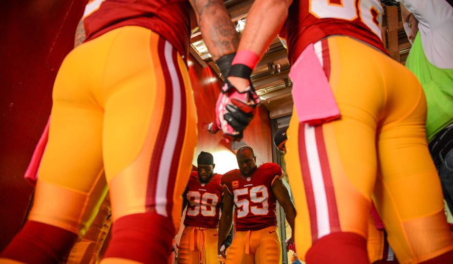 Washington Redskins inside linebacker London Fletcher (59) leads the defense in a pre game talk in the tunnel before the Washington Redskins play the Chicago Bears at FedExField, Landover, Md., Sunday, October 20, 2013. (Andrew Harnik/The Washington Times)