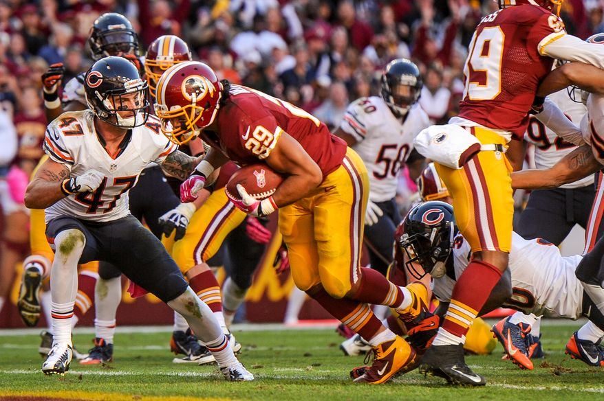 Washington Redskins running back Roy Helu (29) scores the go-ahead touchdown on a 3 yard run late in the fourth quarter as the Washington Redskins defeat the Chicago Bears 45-41 at FedExField, Landover, Md., Sunday, October 20, 2013. (Andrew Harnik/The Washington Times)