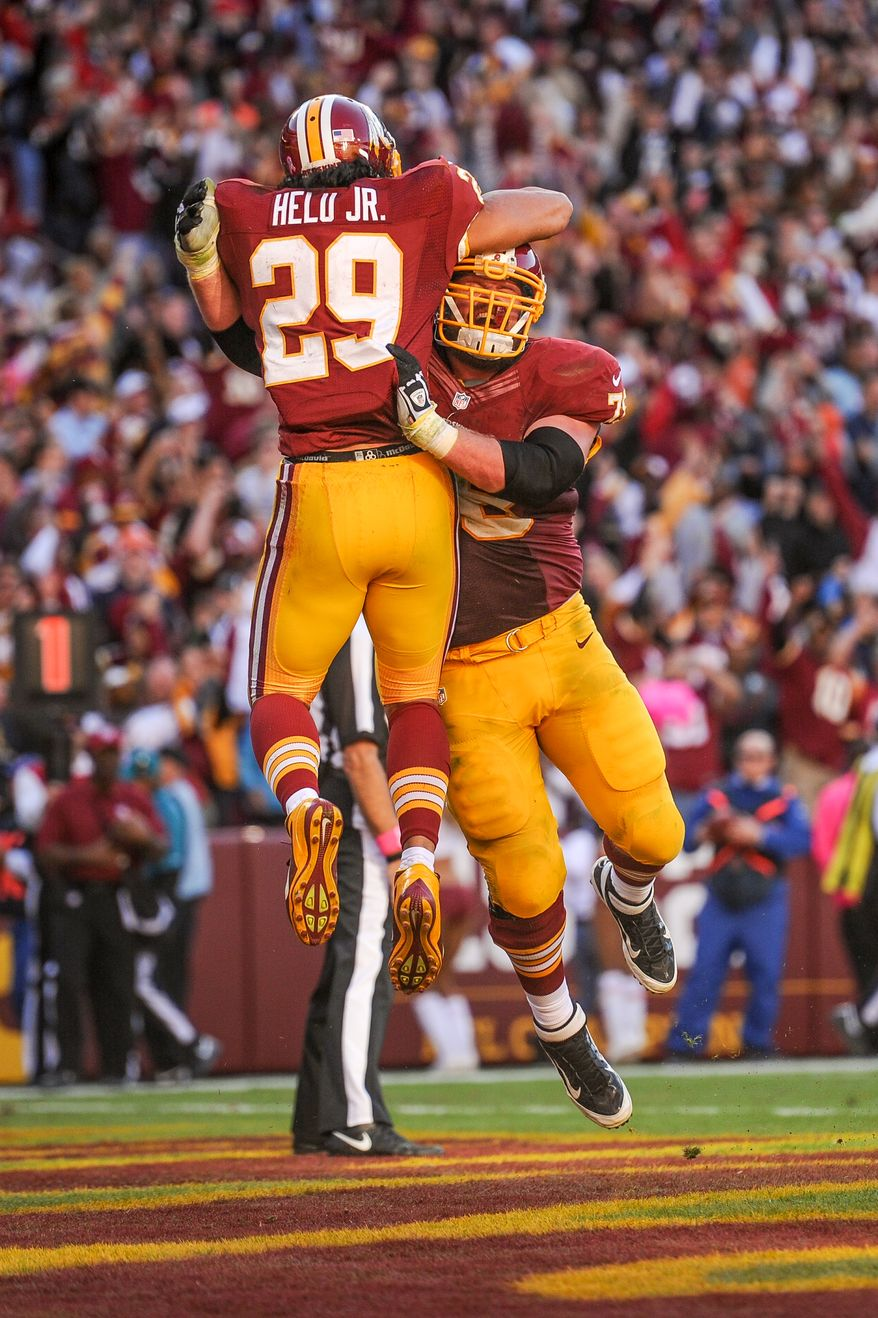 Washington Redskins guard Kory Lichtensteiger (78) celebrates with Washington Redskins running back Roy Helu (29) as he scores the go-ahead touchdown on a 3 yard run late in the fourth quarter as the Washington Redskins defeat the Chicago Bears 45-41 at FedExField, Landover, Md., Sunday, October 20, 2013. (Andrew Harnik/The Washington Times)