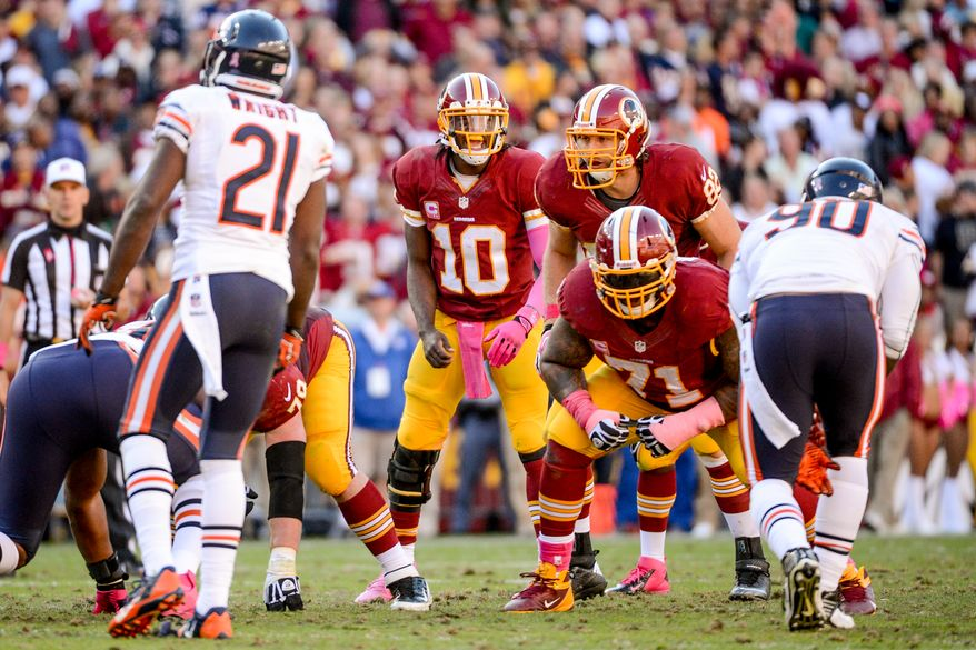 Washington Redskins quarterback Robert Griffin III (10) yells at the line before a snap on a late drive in the fourth quarter as the Washington Redskins play the Chicago Bears at FedExField, Landover, Md., Sunday, October 20, 2013. (Andrew Harnik/The Washington Times)