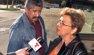 Sandra Zea (right), with her husband, Albaro Zea, speaks to reporters outside the U.S. District Courthouse in Central Islip, N.Y., following the arraignment of their son, Marcos Alonzo Zea, on Friday, Oct. 18, 2013. The younger Mr. Zea was ordered held without bail after pleading not guilty to charges that he sought to join an al Qaeda group in Yemen. (AP Photo/Frank Eltman)