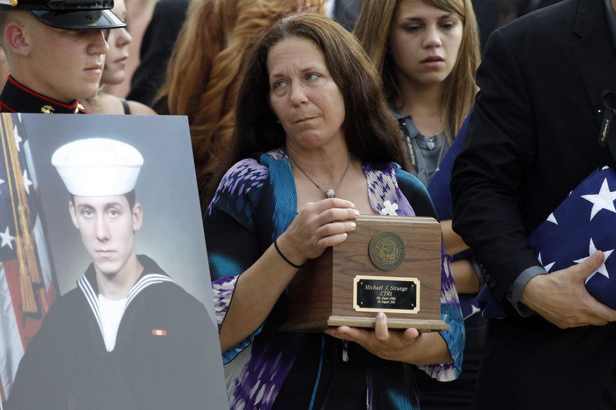 Elizabeth Strange, center, carries her son's remains, with Breanna Hostetler, fiance of the deceased, right, as they depart after a a flag presentation ceremony for U.S. Navy Petty Officer 1st Class Michael Joseph Strange, a cryptology technician, in Logan Circle Thursday, Aug. 18, 2011, in Philadelphia. Strange was assigned to the Navy SEAL team whose Chinook helicopter was shot down Aug. 6 by a rocket-propelled grenade in what has become the deadliest single loss for U.S. forces in the decade-long war in Afghanistan. (AP Photo/Alex Brandon)