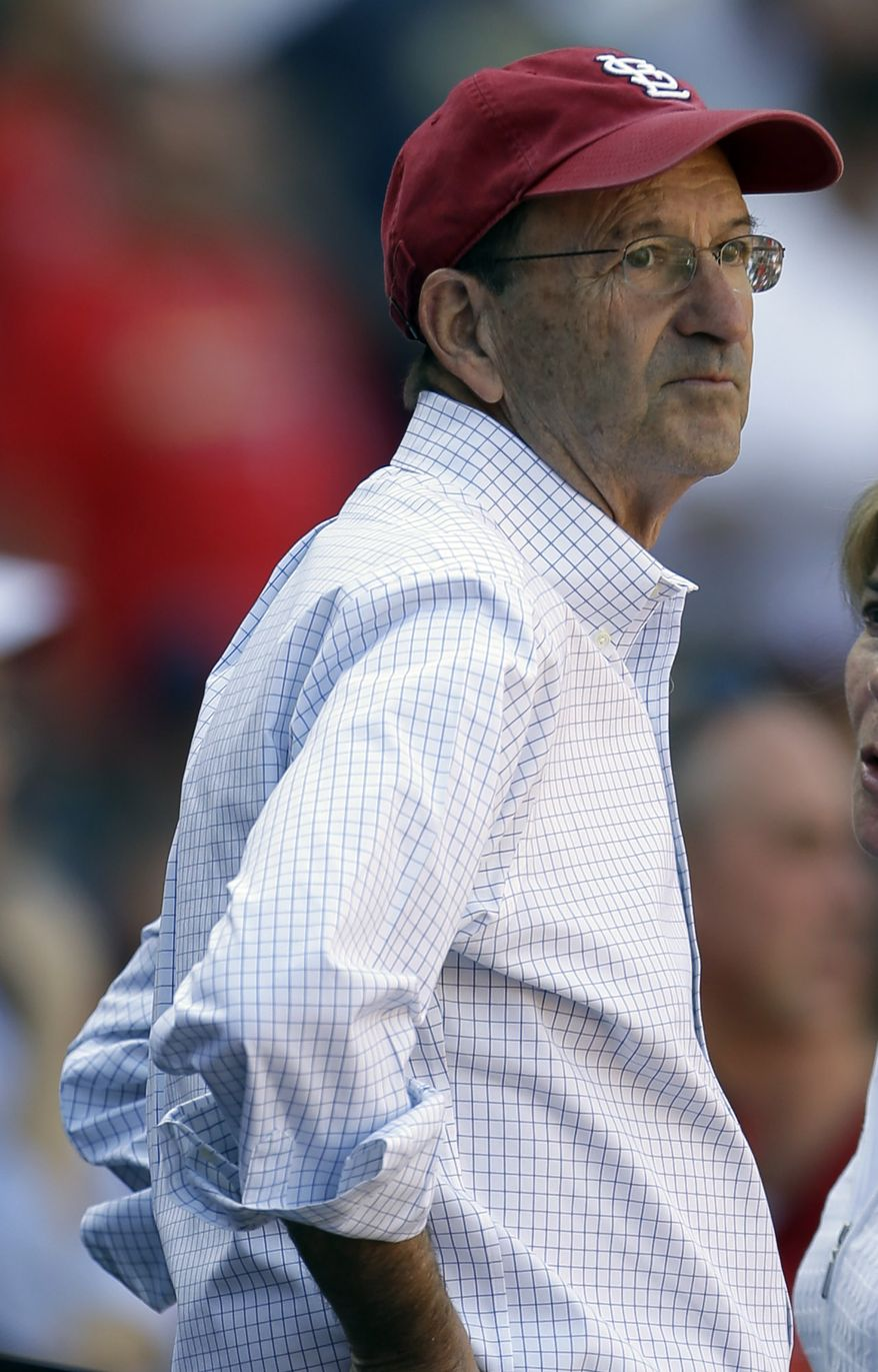 St. Louis Cardinals owner Bill DeWitt Jr. stands during the seventh inning of a baseball game between the St. Louis Cardinals and the Houston Astros Thursday, Sept. 20, 2012, in St. Louis. (AP Photo/Jeff Roberson)