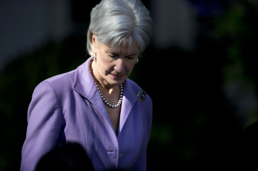 Health and Human Services Secretary Kathleen Sebelius arrives in the Rose Garden of the White House in Washington, Monday, Oct. 21, 2013, for and event with President Barack Obama on the initial rollout of the health care overhaul. Obama acknowledged that the widespread problems with his health care law's rollout are unacceptable, as the administration scrambles to fix the cascade of computer issues. (AP Photo/ Evan Vucci)