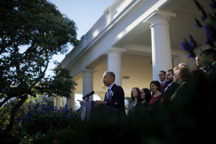 President Obama, standing with supporters of his health care law, speaks in the Rose Garden of the White House in Washington on Monday, Oct. 21, 2013, about the initial rollout of the health care overhaul. Mr. Obama acknowledged that the widespread problems with the health care law's implementation are unacceptable as the administration scrambles to fix the cascade of computer issues. (AP Photo/Charles Dharapak)